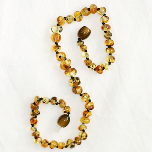 healing amber baby necklace - olive
